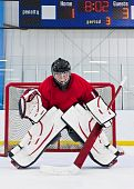 foto of ice hockey goal  - Ice hockey goalie in front of his net - JPG