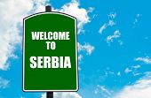 image of serbia  - Green road sign with greeting message WELCOME TO SERBIA isolated over clear blue sky background with available copy space - JPG