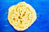 image of flat-bread  - Pita bread flat bread pita tortilla on a blue wooden background - JPG