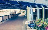 stock photo of homeless  - Japanese man homeless sleeps under the bridge - JPG