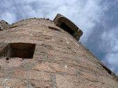 stock photo of martello  - close in and looking up at a round tower  - JPG