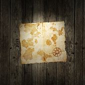 pic of treasure map  - old treasure map on wooden grunge background - JPG
