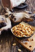 image of salt-bowl  - salted peanut nuts in a bowl on the old wooden background - JPG