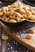 pic of salt-bowl  - salted peanut nuts in a bowl on the old wooden background. snacks. close-up. selective focus ** Note: Shallow depth of field - JPG