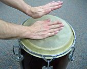 foto of congas  - two hands playing a conga drum - JPG