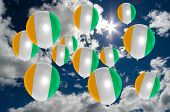 picture of ivory  - many ballons in colors of ivory coast flag flying on sky - JPG