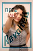 foto of revolt  - young woman turning off Revolted on screen - JPG
