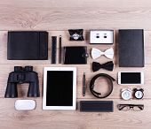 picture of black-belt  - Set of black and white accessories on wooden table - JPG