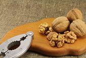 stock photo of nutcracker  - Walnuts on a wooden board  - JPG