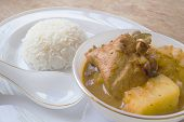 stock photo of curry chicken  - Chicken mussaman curry in bowl and rice - JPG