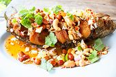 picture of snakehead  - deep fried fish with herb and spicy sauce thai food - JPG