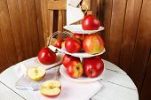 picture of serving tray  - Tasty ripe apples on serving tray on table on wooden background - JPG