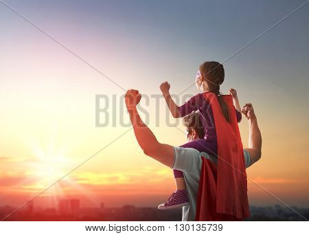 Happy loving family. Father and his daughter child girl playing outdoors. Daddy and his child girl i