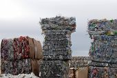 foto of reprocess  - recycle center with bundles of plastic and cans - JPG