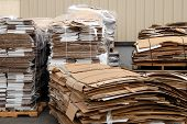 picture of reprocess  - recycle center with pallets of recycled cardboard - JPG