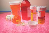 foto of mg  - a collection of prescription medicines on illuminated glass - JPG