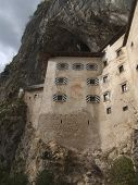 Predjama Castle Sunny Below Perspective poster