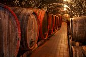 stock photo of wine cellar  - Wine barrels stacked in the old cellar of the winery - JPG