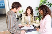 foto of people work  - Casual business team working together at office reception - JPG
