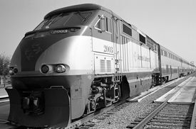 stock photo of amtrak  - amtrak california diesel engine with passenger cars - JPG