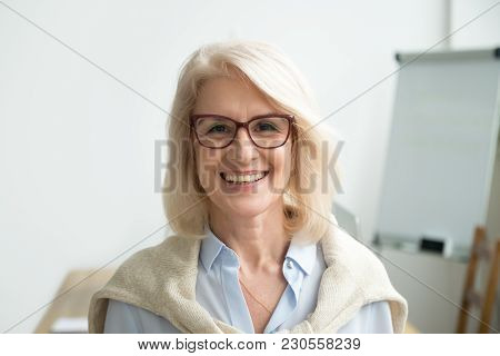Smiling Attractive Senior Businesswoman Wearing