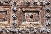 Antique Decorated Wooden Door Keyhole. Vintage Background. Horizontal poster