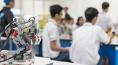 Robotic Lab Class With School Students Blur Background Learning In Group Having Study Workshop In Sc poster