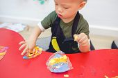 Cute Asian 18 Months Old Toddler Boy Child Playing Modeling Clay / Play Dought At Play School, Creat poster
