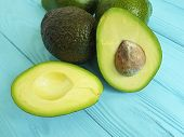 fresh avocado on blue wooden copy, heap, calories, dinner, lifestyle, meal, pulp, whole poster