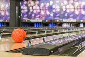 bowling ball rolls in between of the bumper rails, certain to hit target poster
