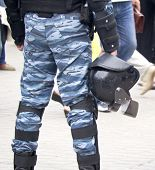 pic of truncheon  - Helmet on a police officer in the street - JPG