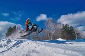 Extreme Sport Race Snowmobiles. Snowmobile In Jump Above Track. Sportsman On Snowmobile. Winter Comp poster