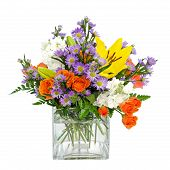 image of flower arrangement  - Colorful flower arrangement centerpiece in square glass vase with roses - JPG
