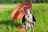 image of hmong  - Portrait Hmong from Laos with parasol and traditional national costume - JPG