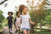 Cute African American Little Girl Playing Outdoor - Black People Kid And Friend Happy. poster