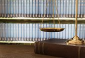Scales Of Justice On Law Books In A Courtroom Or Law Firm. Concept Of Law,legal Education. poster