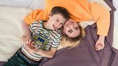 Mother With Son On Bed, Mother And Son Having Fun, Happy Mom And Her Teenager Son Lying On Bed, Moth poster