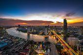 Skyscraper On Night Scene Cityscape At Chaopraya River In Bangkok Metropolis Thailand poster
