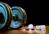 Steroid Pills And Capsules With Dumbbell Weight In The Background - Doping In Sport. poster