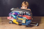 Baby Boy And Travel Suitcase. Kid And Luggage Packed For Vacation Full Of Clothes, Child And Family  poster