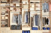 Large wardrobe closet with different clothes, shoes and home stuff poster