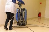 Floor Care And Cleaning Services With Washing Machine In Shopping And Entertainment Center.the Direc poster