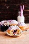 Cupcakes With Mascarpone Cream Cheese, Black Currant Jelly Jam And Freshly Shredded Coconut On A Woo poster