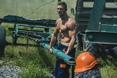 Sexy Worker Concept. Muscular Builder On Sunny Day. Sexy Man With Nude Torso Work With Construction  poster