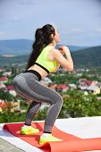 Sexy Woman Bend Knees On Natural Landscape, Training. Woman Athlete Training On Sunny Summer Day, Sp poster