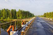 The Bridge Across The Siberian Taiga And The River.simple And Reliable Design poster