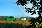 Two Agricultural Machines Operate In The Field, Agricultural Land, Ain Harvesting Machines Operate I poster