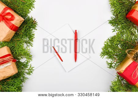 poster of Notebook With Pen On Christmas Background. Empty White Notebook And Pen On White Christmas Backgroun
