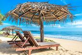 Tropical Beautiful Beach In Sri Lanka. Ocean And Nice Sandy Shore With Beach Beds And Umbrellas. Sun poster