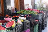 Local Market Offering Local Products. Products Are Laid Out In Plastic Boxes: Watermelons, Melons, P poster
